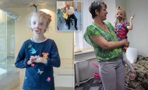 Russian girl who was born with no lips or chin flies to UK for surgery