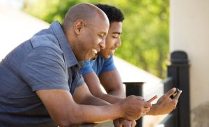 What influences how parents and their gay adolescent sons discuss sexual health at home?