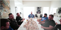 Watch The Mountain Challenge His Friends to Eat 200 Burgers in 30 Minutes