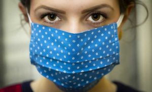 Wearing face masks at home might help ward off COVID-19 spread among family members