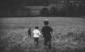 Reviews find children not major source of COVID-19, but family stress is high