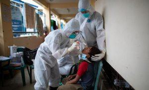 Philippines reports record high 8,773 new coronavirus infections