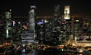 Singapore steps up virus curbs as infection clusters grow