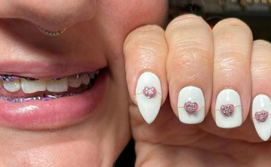 This Nail Artist Put Real Braces on Her Vampire-Teeth Manicure